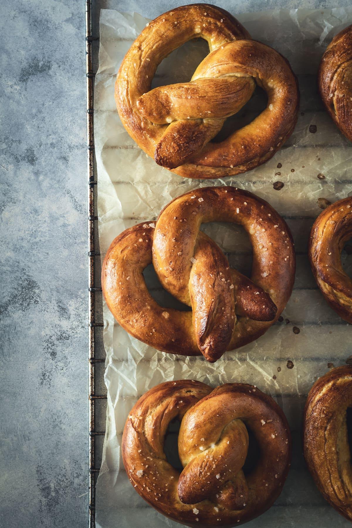 3 golden-brown pretzels.