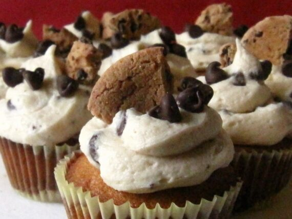 A Bunch of Frosted Cupcakes with Chips Ahoy Cookies and Chocolate Chips on Top