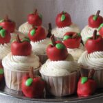 Image of teacher appreciation cupcakes with red oreo truffle apples