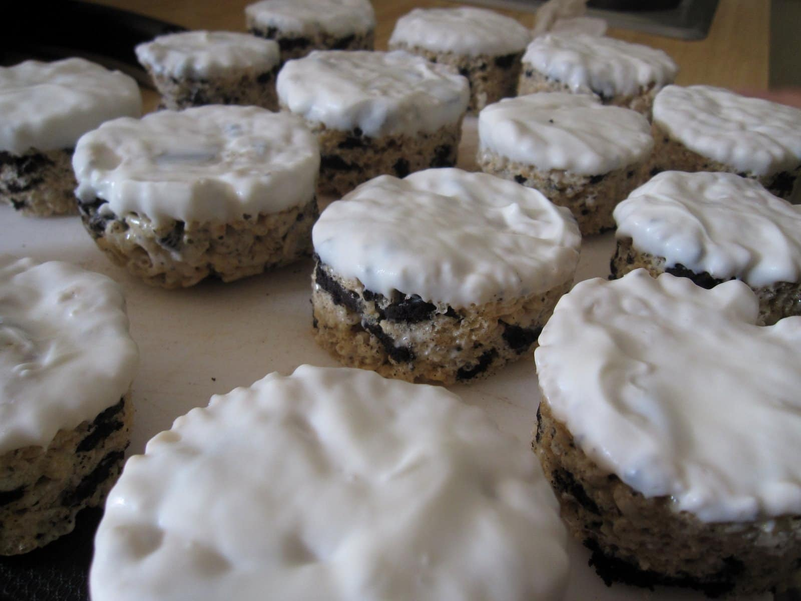Several Oreo Krispie circles with white chocolate on top