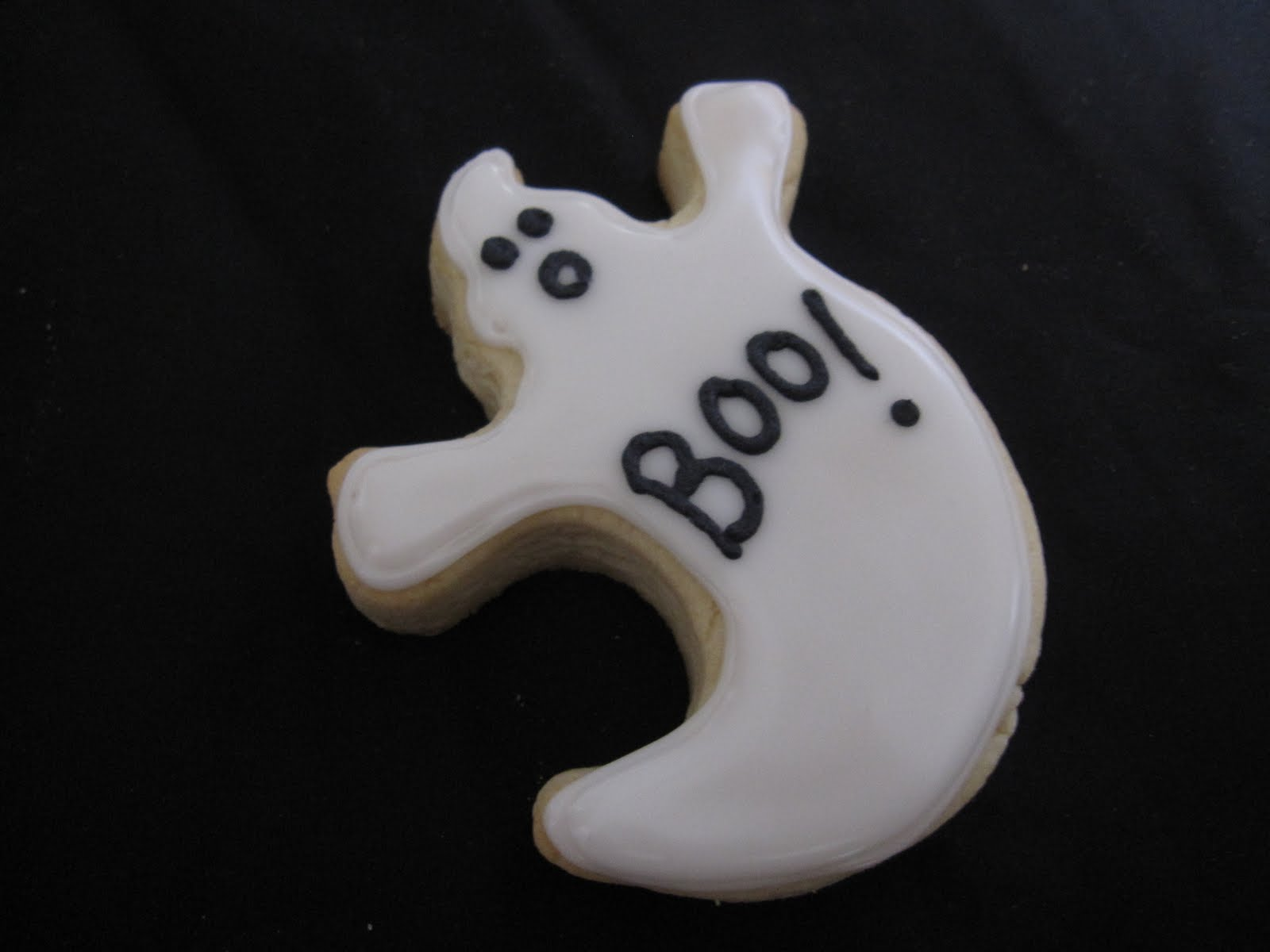 A white frosted Halloween ghost cookie