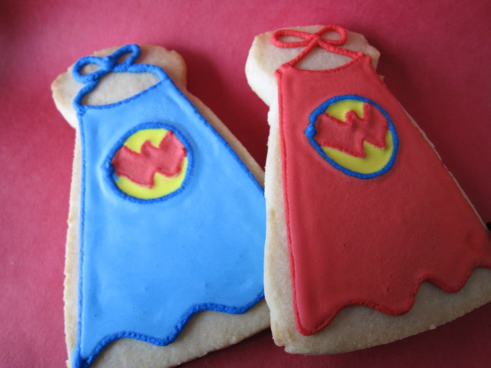 Two frosted cookies decorated as Wonder Pets capes