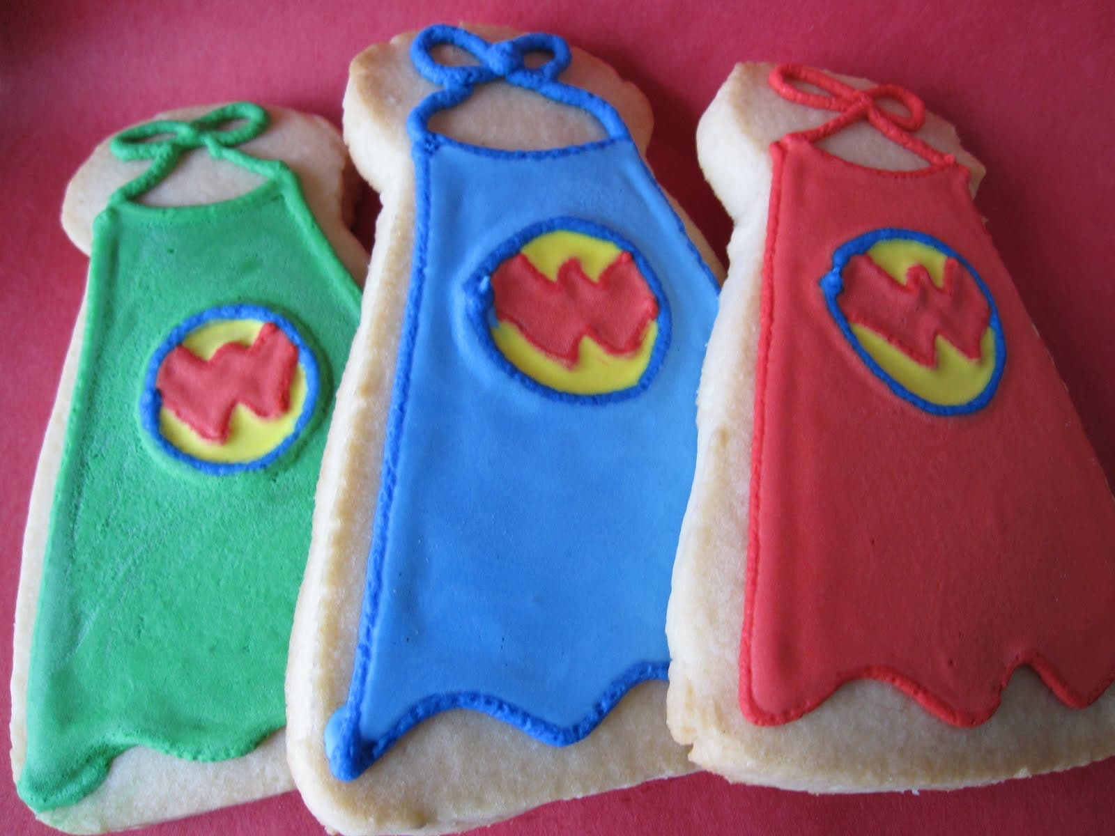 3 cookies decorated as Wonder Pets capes