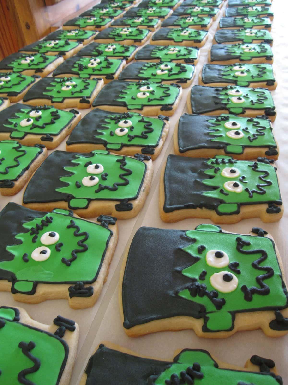 Dozens of Frankenstein decorated cookies in rows