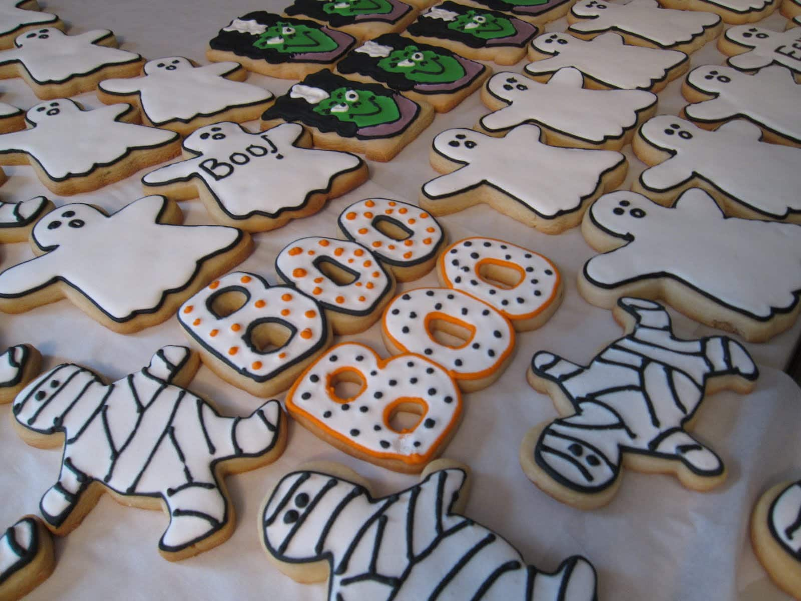 A variety of Halloween decorated frosted cookies