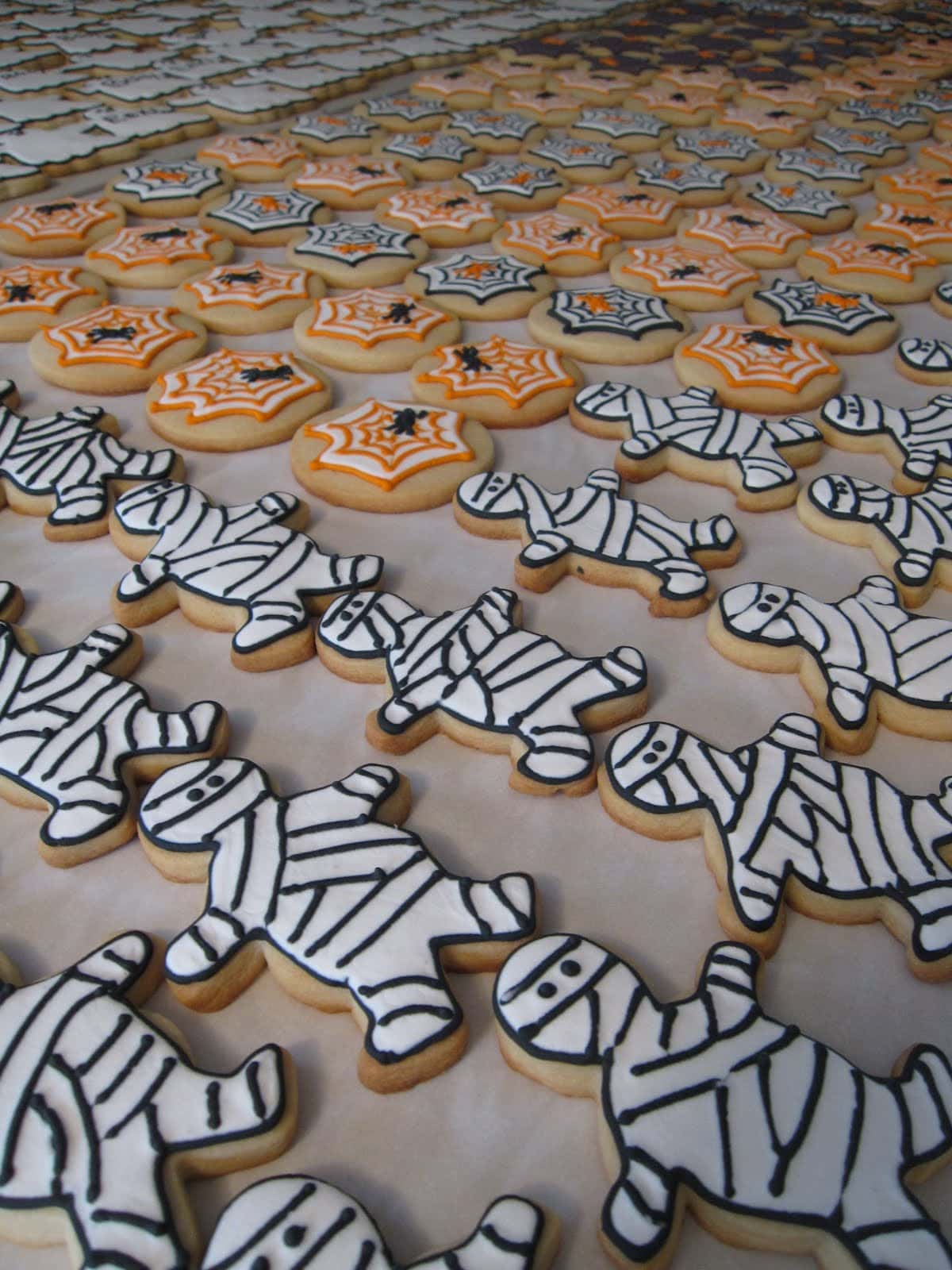 A variety of Halloween-themed frosted cookies