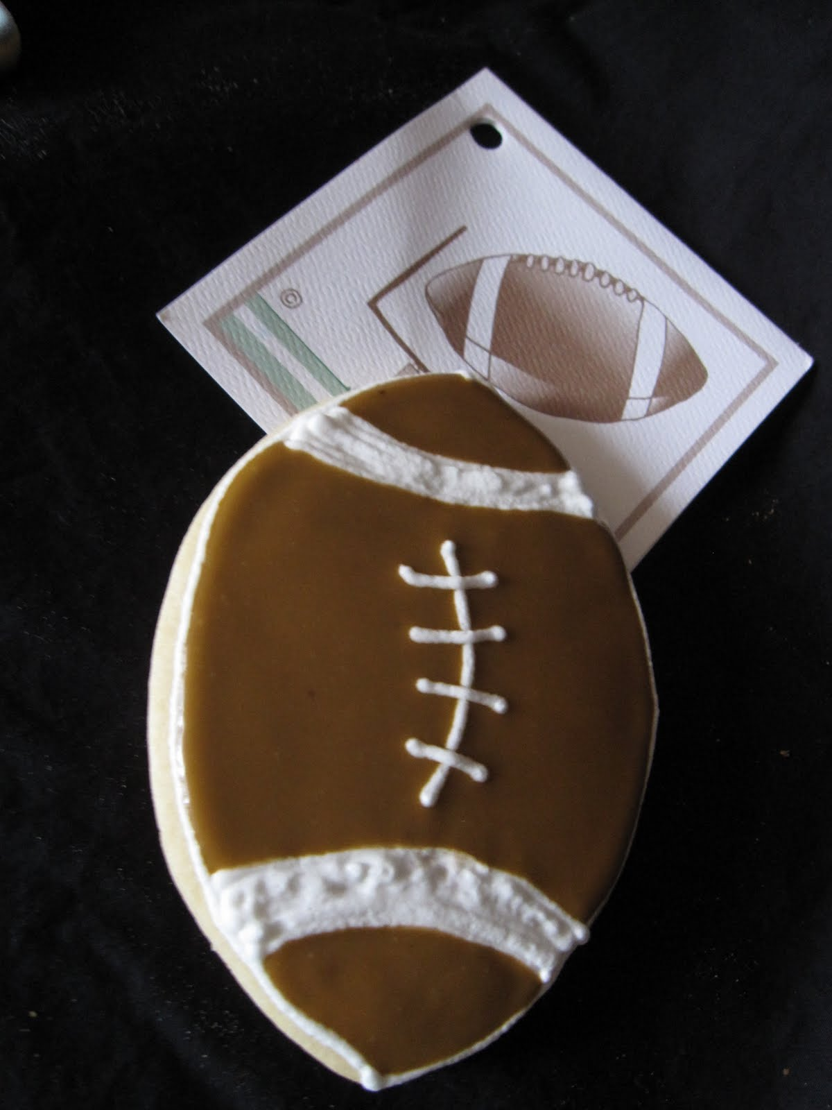 Cookie decorated as a football
