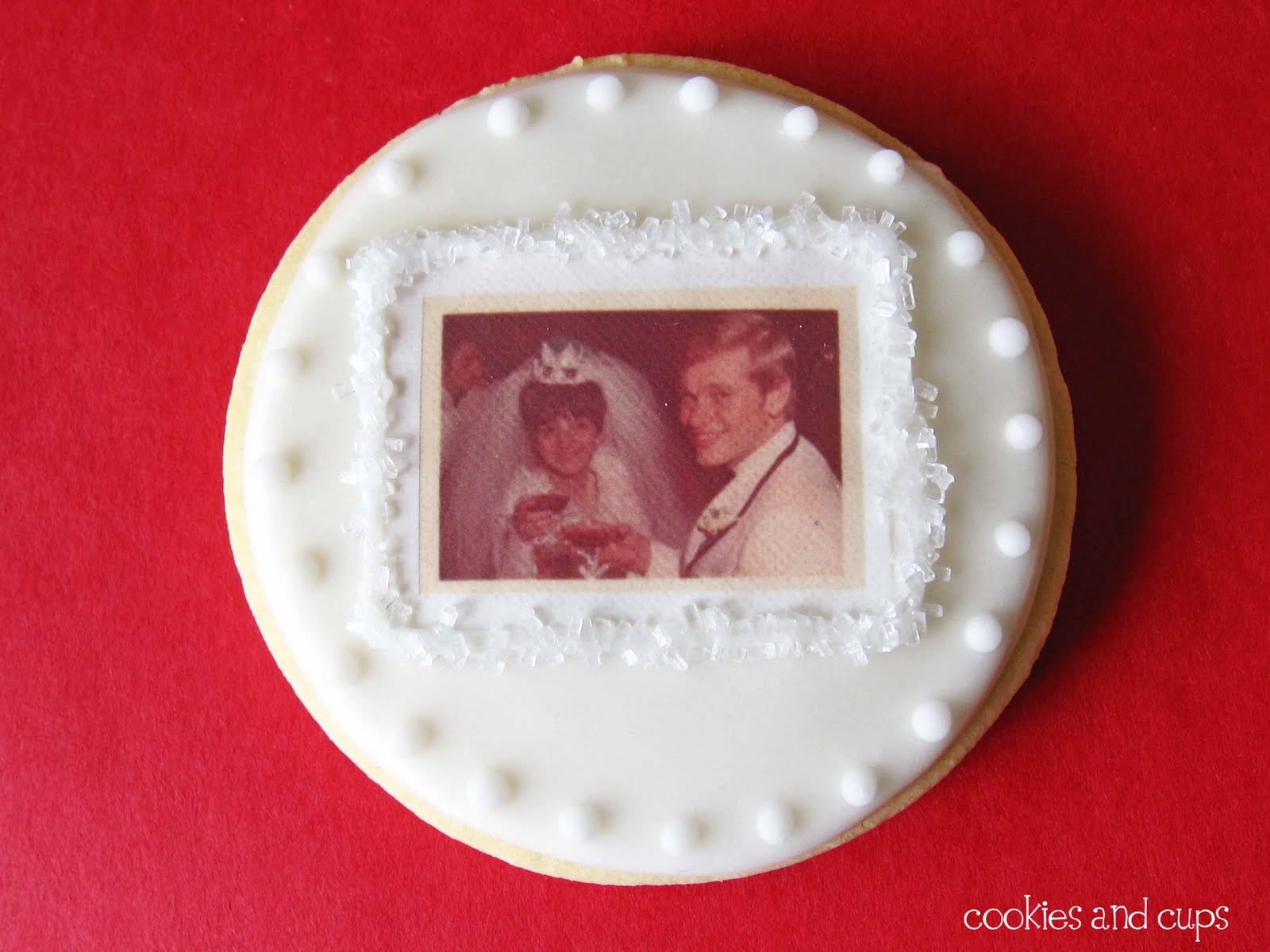 Decorated sugar cookie with anniversary photo on edible sheet