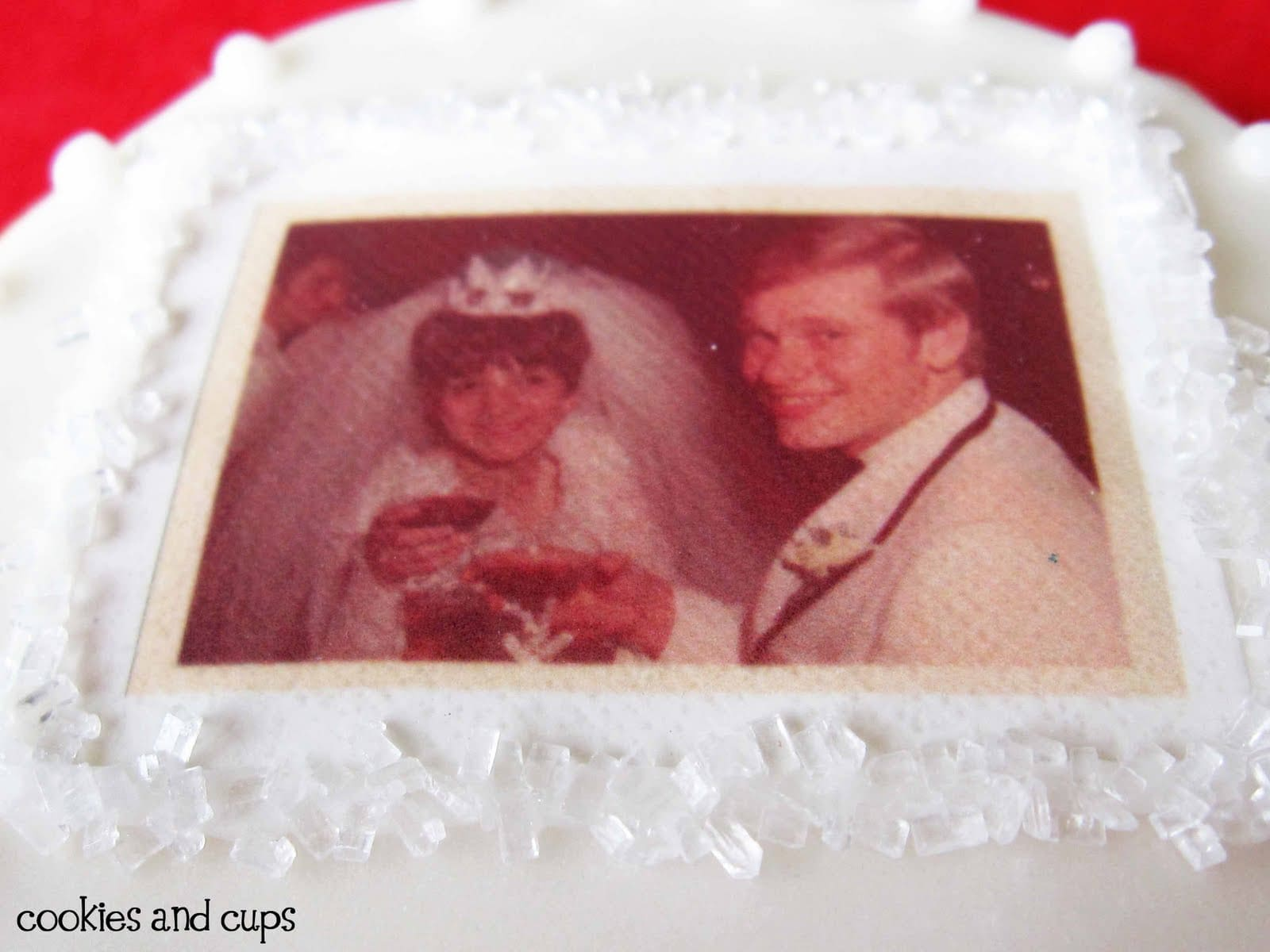 Close-up of a white frosted anniversary cookie with photo