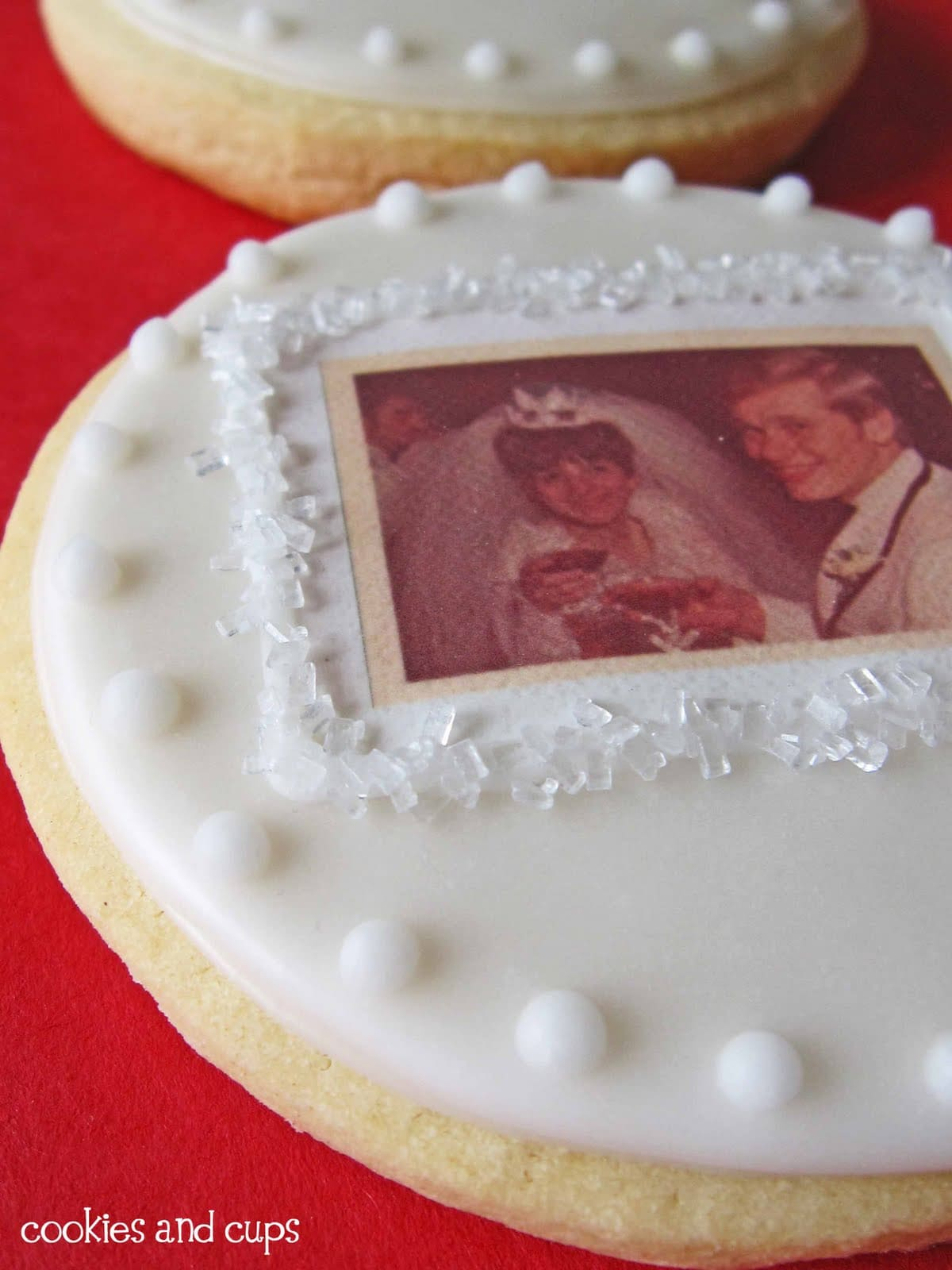 Close-up of a white anniversary cookie with photo