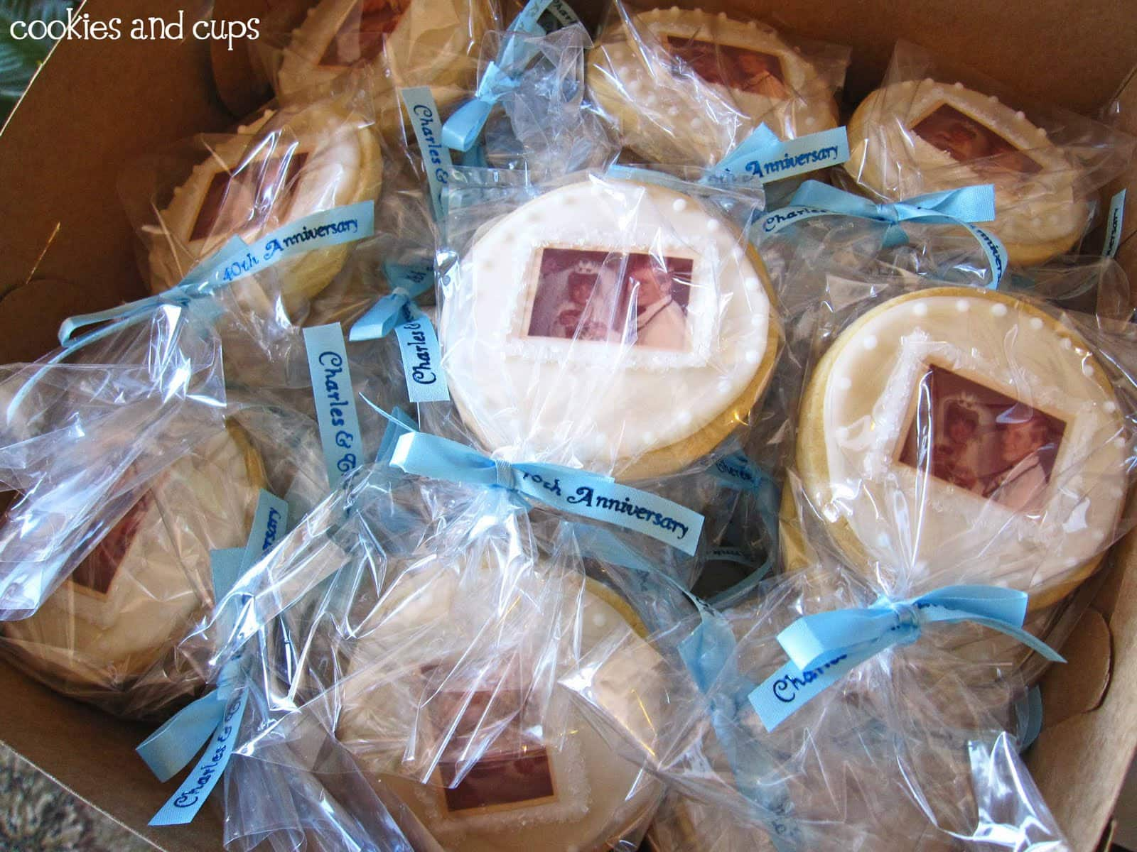 Individually bagged anniversary cookies with blue ribbons
