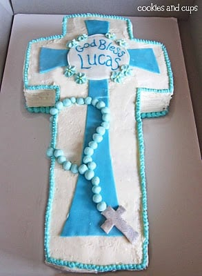 A Blue and White Communion Cake in a Gray Cardboard Box