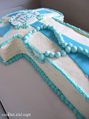 The Side of a Communion Cake with Blue Frosting Beads Bordering the Buttercream