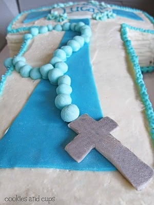 A Close-Up Shot of the Rosary Frosting Decoration on a Communion Cake