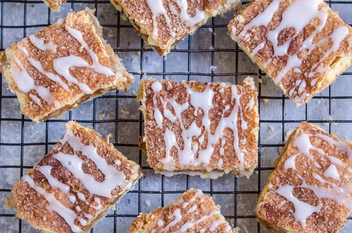 Pie bars with glaze drizzle on top.