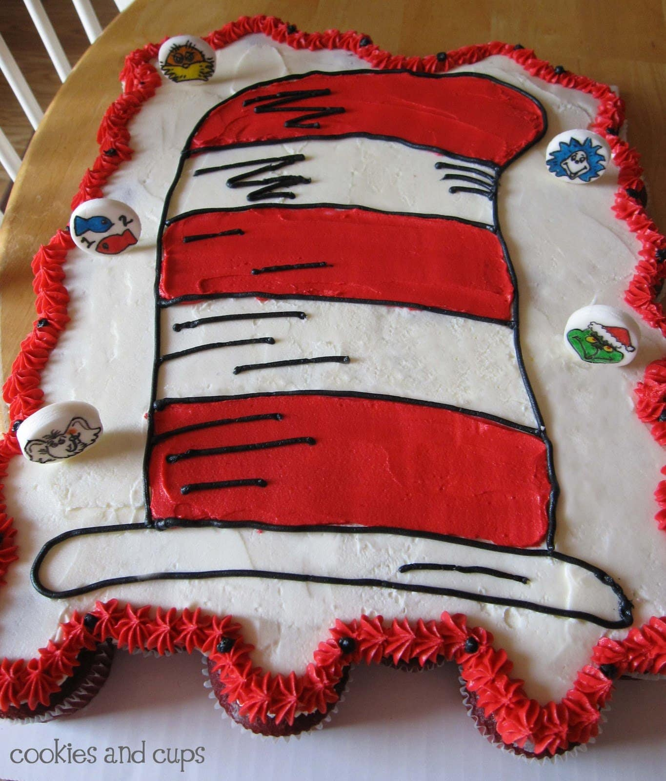 Top view of a red and white cake decorated as a Dr. Seuss hat