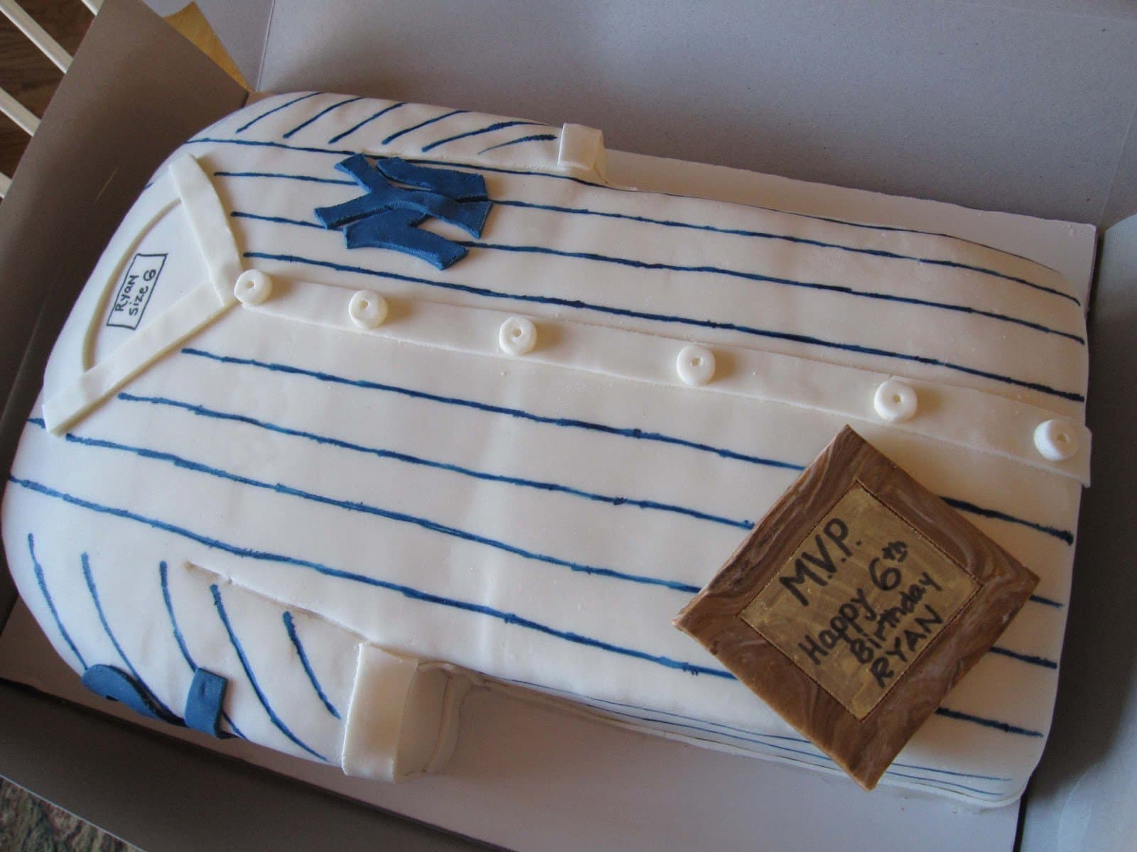Close-up view of a cake decorated as a Yankees jersey
