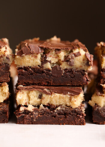 Cookie Dough Brownies stacked on a plate