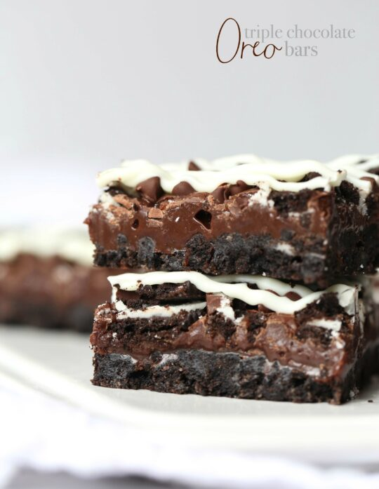 Triple Chocolate Oreo Bars...A creamy fudge layer that sits on top of a crunchy Oreo crust, topped with chocolate chips, MORE Oreos and white chocolate!