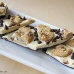 Four Pieces of Chocolate Chip Cookie Bark on a Long, White Dessert Plate