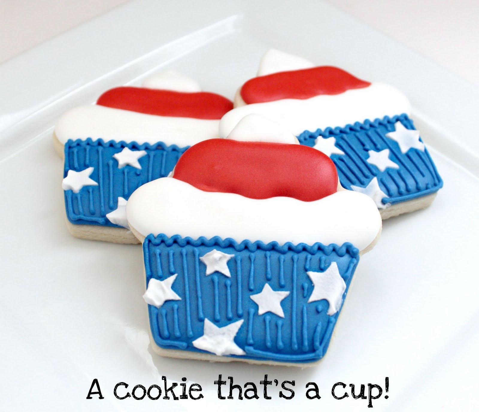 3 stars and stripes cupcake cookies stacked on a plate