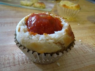 Focaccia cupcake with a meatball and tomato sauce in the center