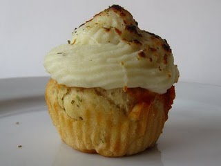 Focaccia cupcake filled with meatball and tomato sauce and topped with a swirl of mashed potatoes