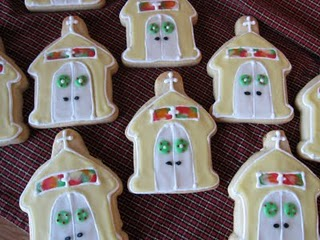 Nine Christmas Sugar Cookies on a Cooling Rack with a Church Decoration in Icing