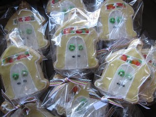 A Pile of Plastic-Wrapped Sugar Cookies with a Christmas Church Decoration