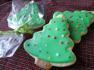 Three Frosted Christmas Tree Sugar Cookies with One Wrapped in Plastic