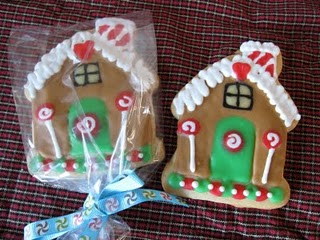Two Decorated Gingerbread House Sugar Cookies on a Plaid Tablecloth
