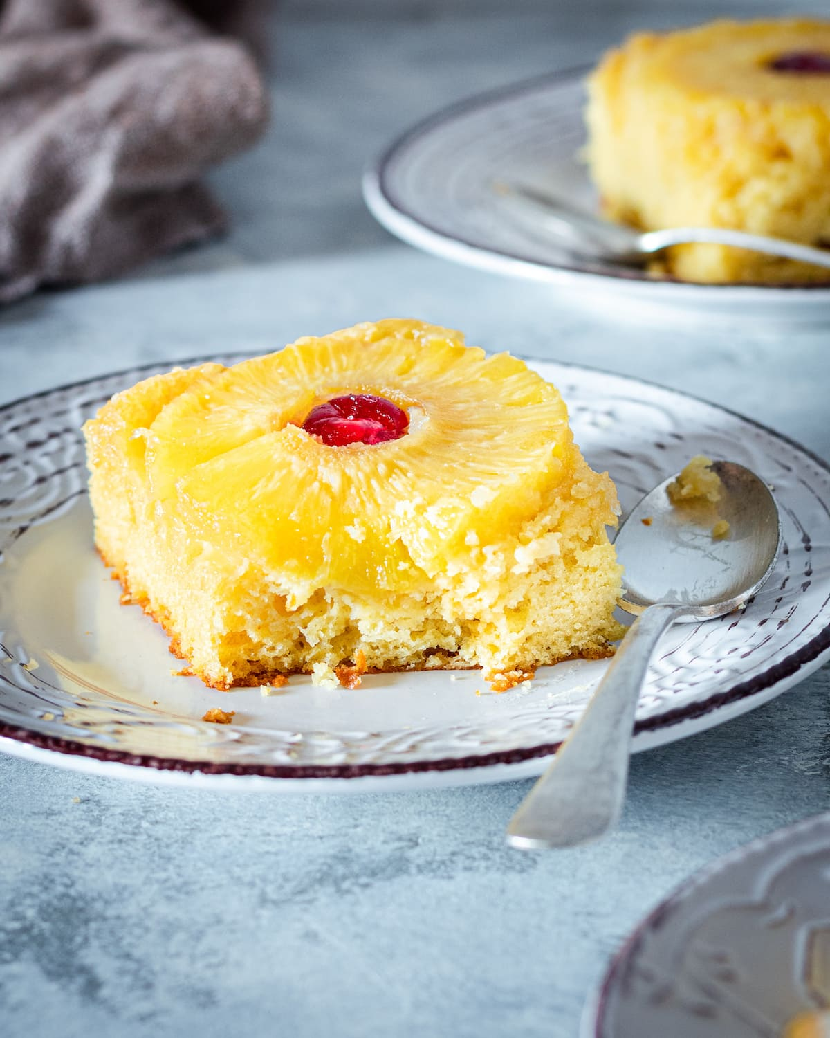 Pineapple upside down cake with a cherry.