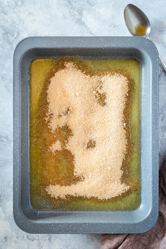 Brown sugar poured into melted butter.