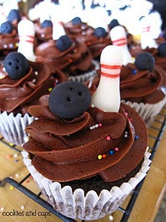 Close-up of chocolate cupcakes with bowling pin and ball decorations