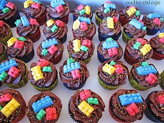 Overhead view of chocolate cupcakes with candy legos