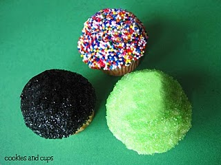 Three cupcakes shown from the top with various sprinkle decorations