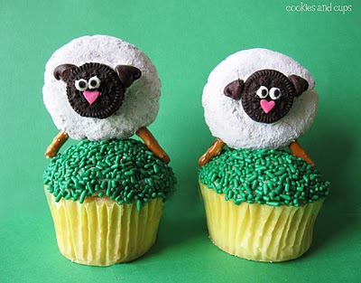 Two Cupcakes Sitting Side by Side with Easter Sheep on Top