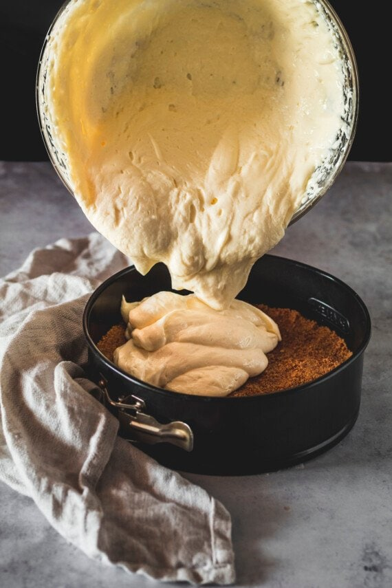 Cheesecake filling poured onto a vanilla cookie crust.