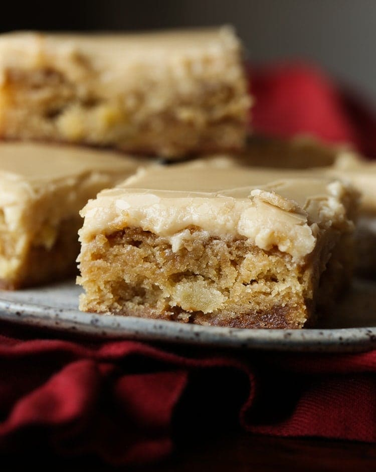 Apple Toffee Blondies are buttery blondies with tart apple pieces and sweet toffee bits! It's topped with a brown sugar frosting!