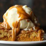 Pumpkin Dump Cake image with ice cream and caramel sauce