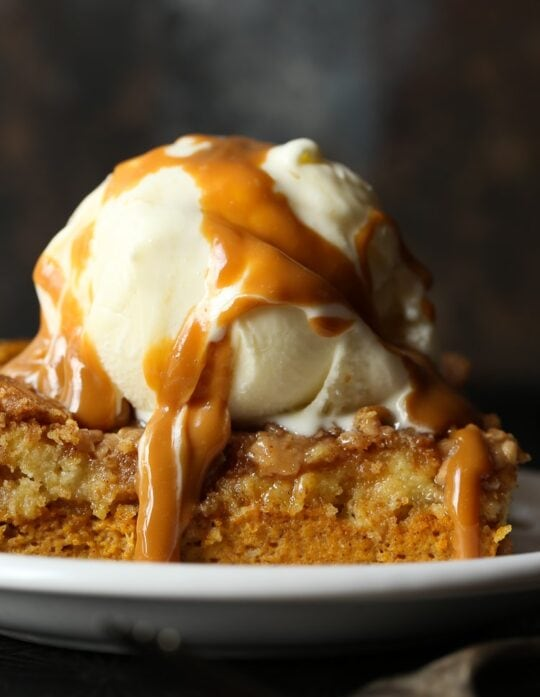 Pumpkin Dump Cake image with ice cream and caramel sauce