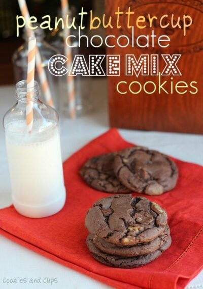 Image of stacked peanut butter cup chocolate cake mix cookies with milk