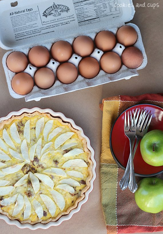 Overhead view of a dozen eggs next to Egg, Sausage, Apple & Cheese tart