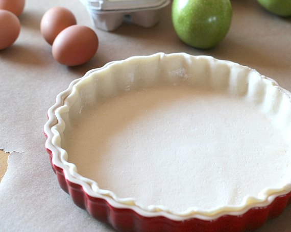 An unbaked pie crust in a pan