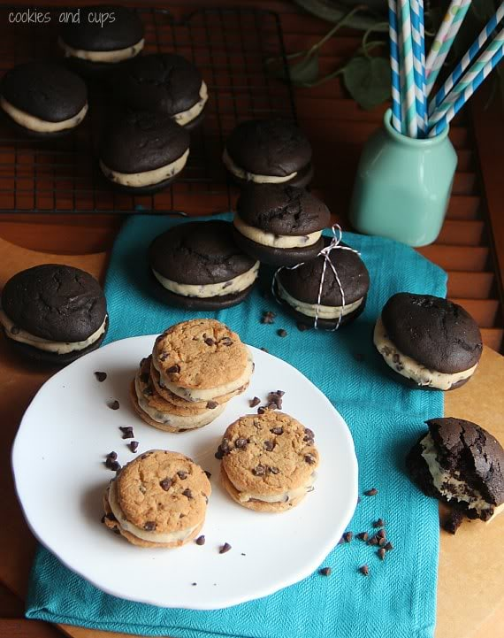 Chocolate chip whoopie pies on a plate surrounded by chocolate whoopie pies with cookie dough filling