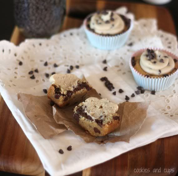 Halved cookie dough cookie cup on a plate