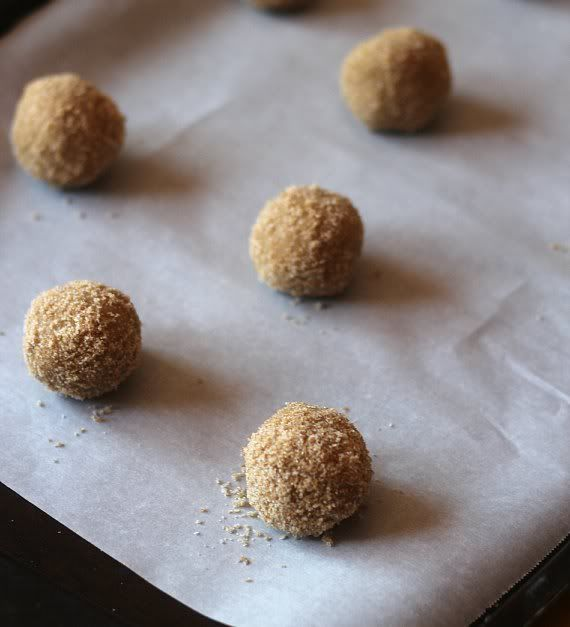 Cookie dough balls on a parchment-lined baking sheet
