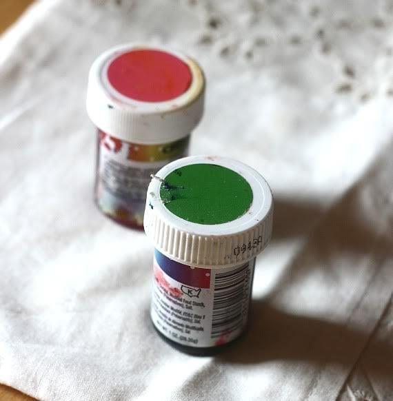Jars of pink and green gel food coloring