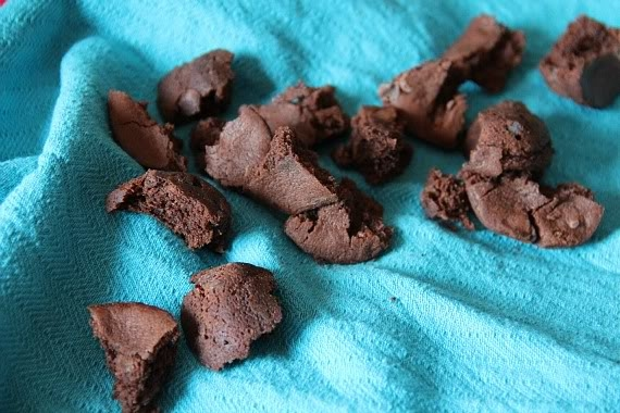 Chopped brownie pieces on a blue cloth
