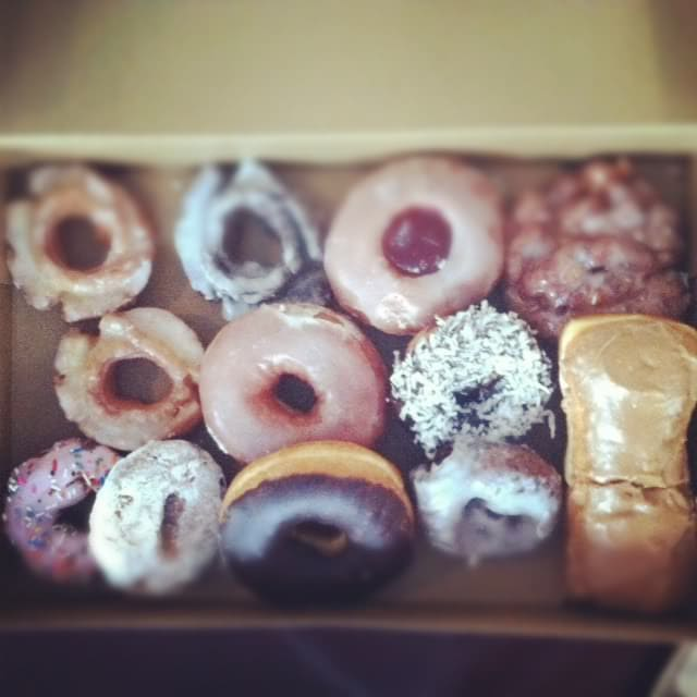 Top view of a box of gourmet doughnuts